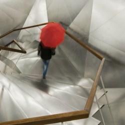 man_walking_red_umbrella_stairs__120387