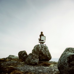 business-woman-in-chair-on-rock-peter-leverman