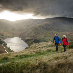 couple_happy_walking_sprayway_mountain_cumbria__113412