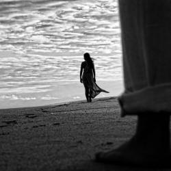 woman_beach_far_away_black_and_white__126229