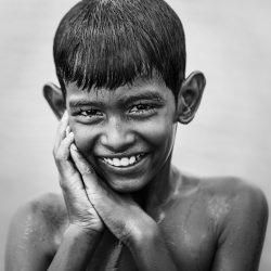 boy_wet_smiling_portrait_black_and_white__119725
