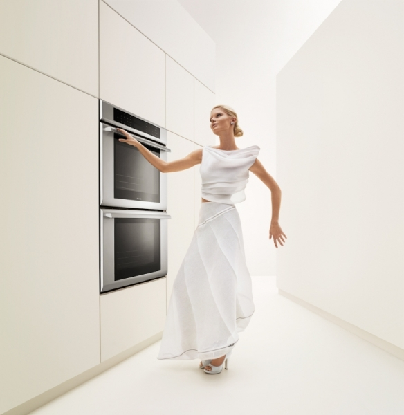 Photograph Stan Musilek Woman In White Kitchen on One Eyeland
