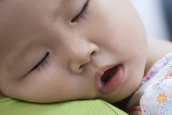 Photograph Nancy Brown Sleeping Asian Baby on One Eyeland