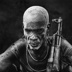Warrior,Mursi tribe-Svetlin Yosifov-bronze-black_and_white-2493